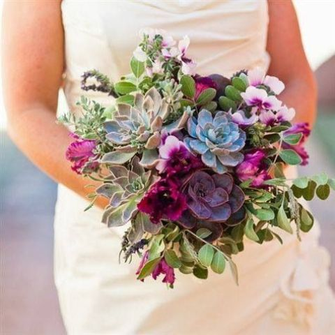 a chic wedding bouquet with pale green and purple succulents, fuchsia blooms and greenery