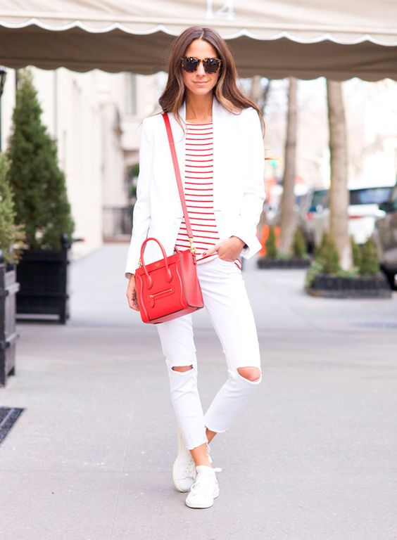 white ripped skinnies, white sneakers, a striped tee, a white blazer and a red bag