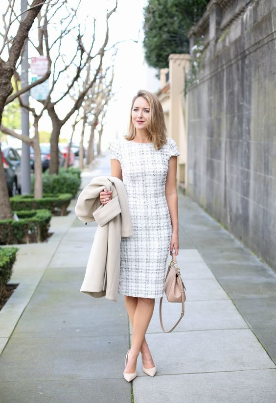 ivory plaid sheath dress with shirt sleeves, cream shoes, a neutral bag and a crema coat