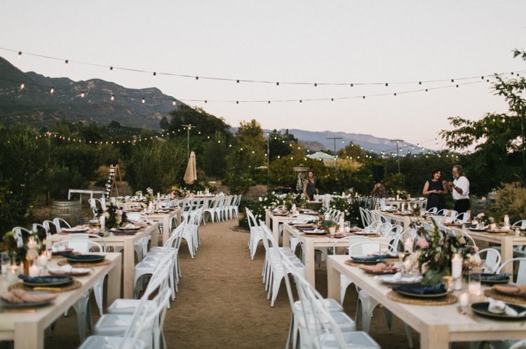 The wedding reception was outdoor, the space was done with lights