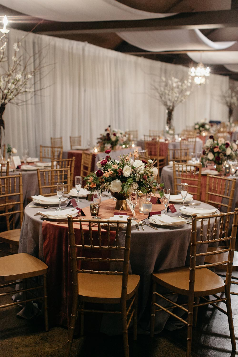 mauve and grey wedding tablescape with gold chiavari chairs
