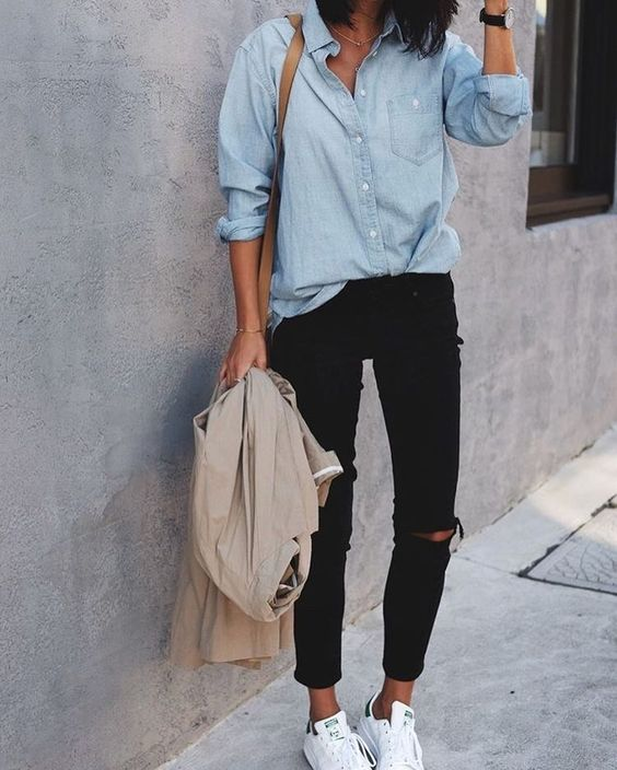 black ripped skinnies, a chambray shirt, white sneakers and a neutral jacket