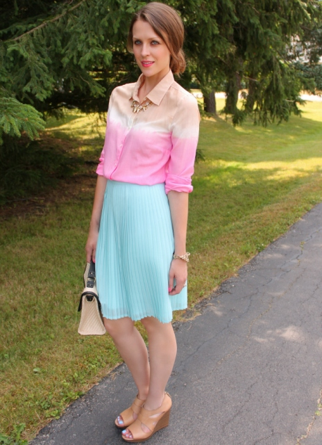 With pleated skirt, beige shoes and two colored bag