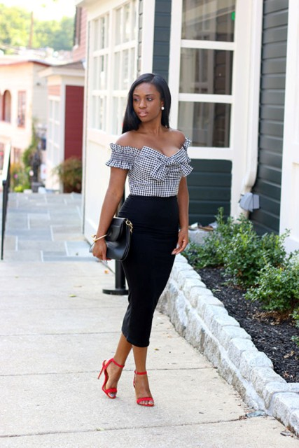 With black midi pencil skirt, clutch and red high heels