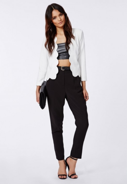 With black leather crop top, black trousers, sandals and black clutch