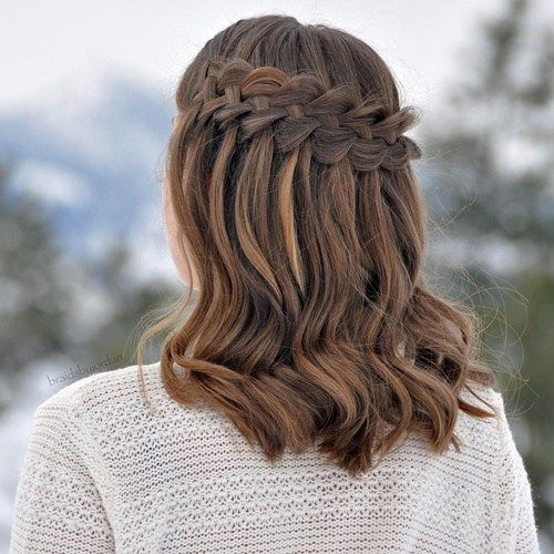 a waterfall braid hairstyle with some waves down for a boho chic feel