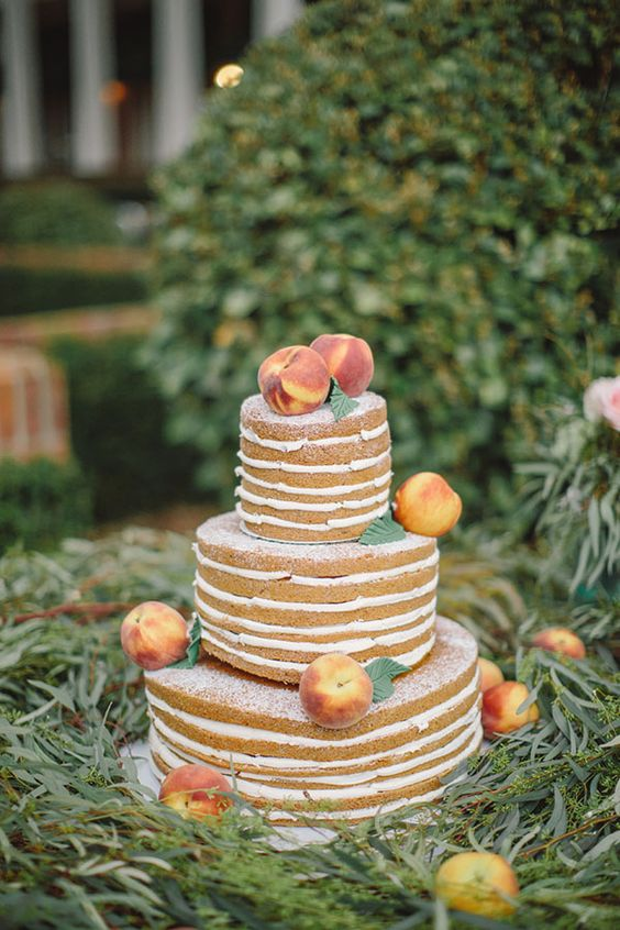 naked peach wedding cake topped fresh peaches for a southern wedding