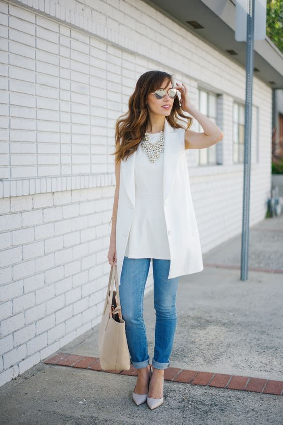 a casual work look with blue skinnies, a white top, a white long vest, layered necklaces and off-white shoes