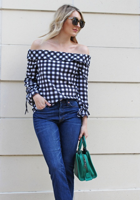 With straight jeans and green bag