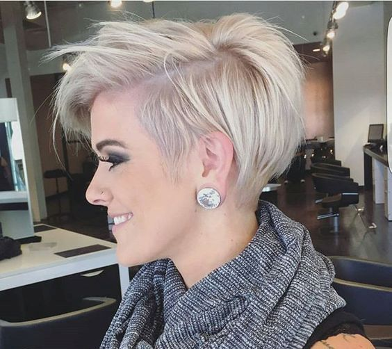 a side swept longer pixie haircut with a side fringe looks very refreshing