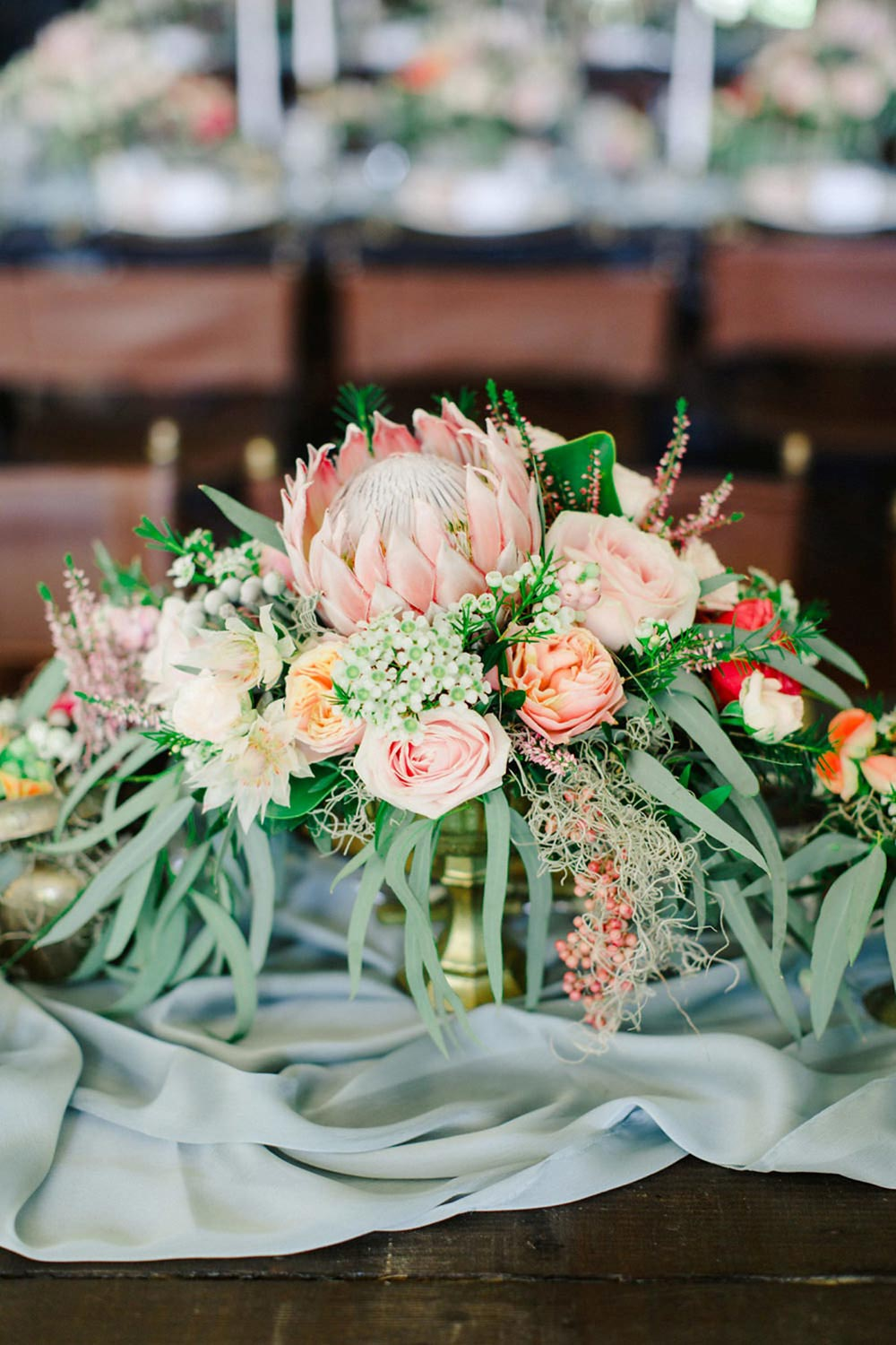 lush protea and olive branch wedding centerpiece