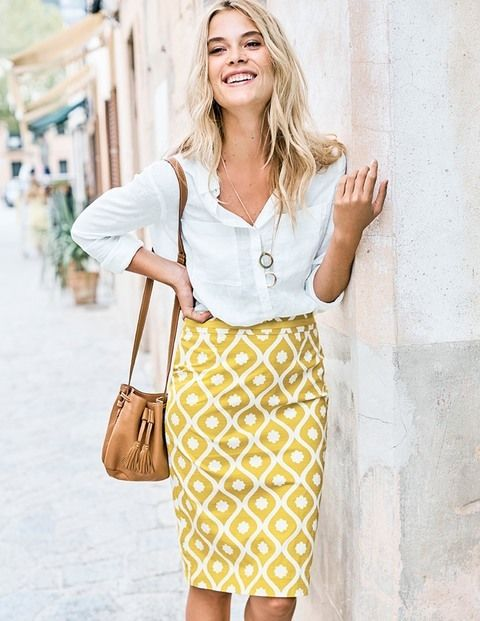 a white button down, a yellow printed pencil skirt and atan bag