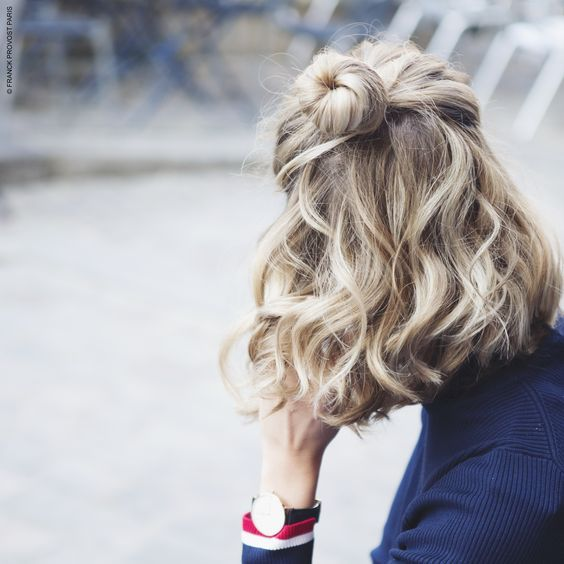 a half updo with a bun and waves can be made in a couple of minutes and looks textural