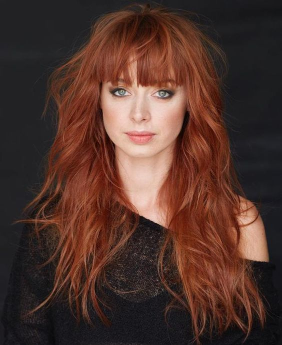 long cascading shag red hair with a long fringe for a messy and romantic look