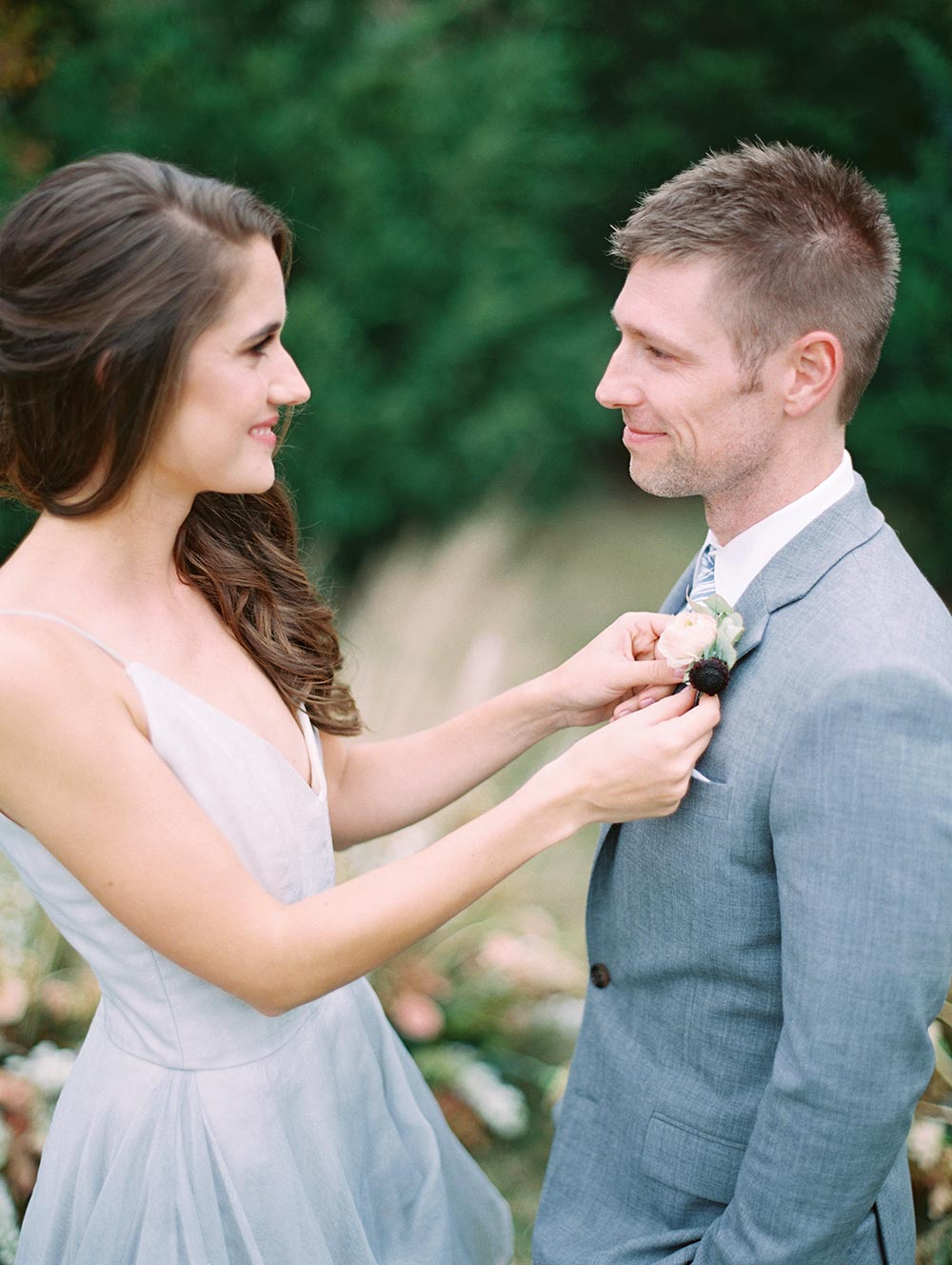 layered silk organza wedding dress and gray groom suit