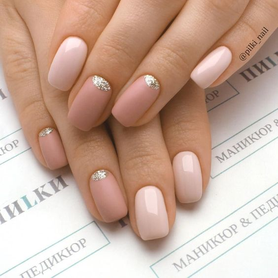 glossy and matte nude and dusty pink nails with silve glitter half moons for a super trendy look