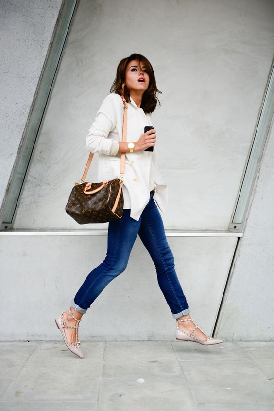 blue skinnies, a white shirt, blush studded flats and a comfy bag can be worn to work