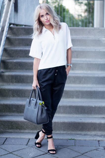 With white loose shirt, black sandals and gray bag