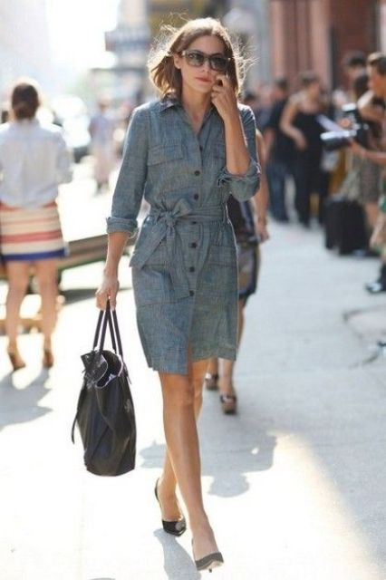 a grey shirtdress with a sash, black buttons and blakc heels and a bag