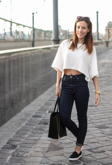 With high-waisted jeans, slip on shoes and tote