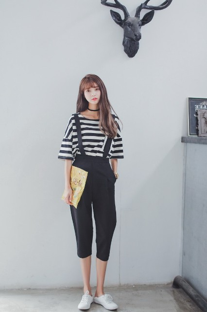 With striped shirt and white sneakers