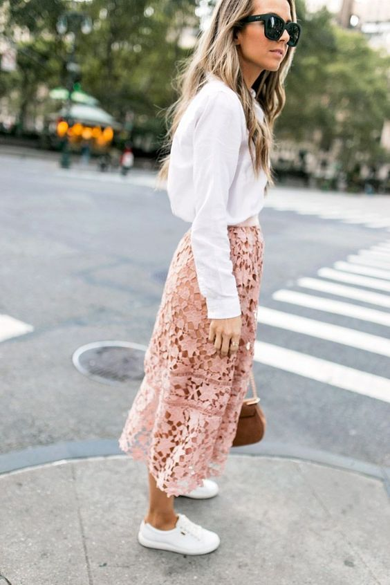 a white button down, a blush lace midi skirt, white sneakers and a brown bag