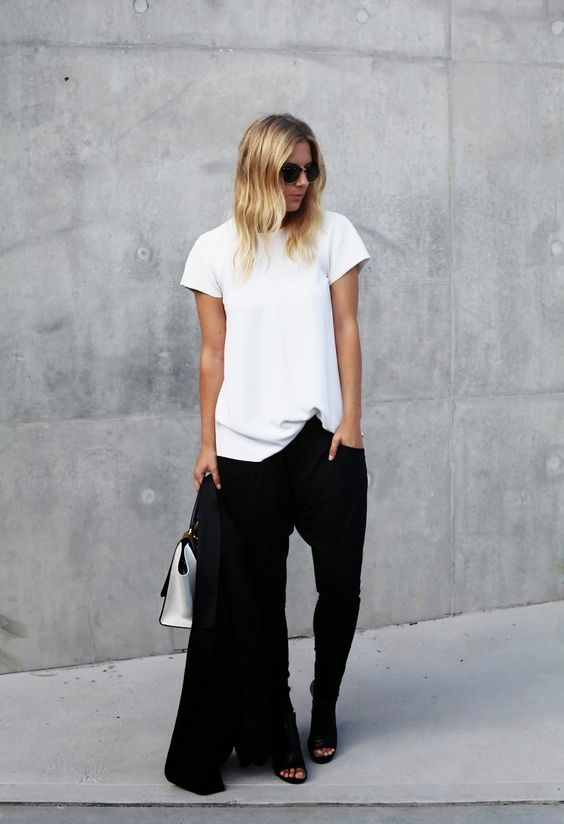 a white tee, black pants, black mules and a black jacket for a minimalist chic office look