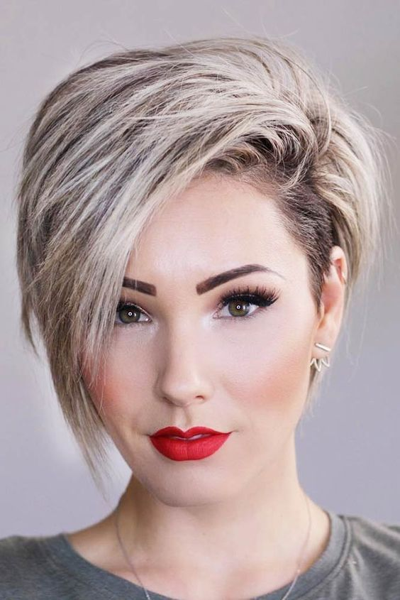 an asymmetric blonde long pixie haircut looks gorgeous and very daring