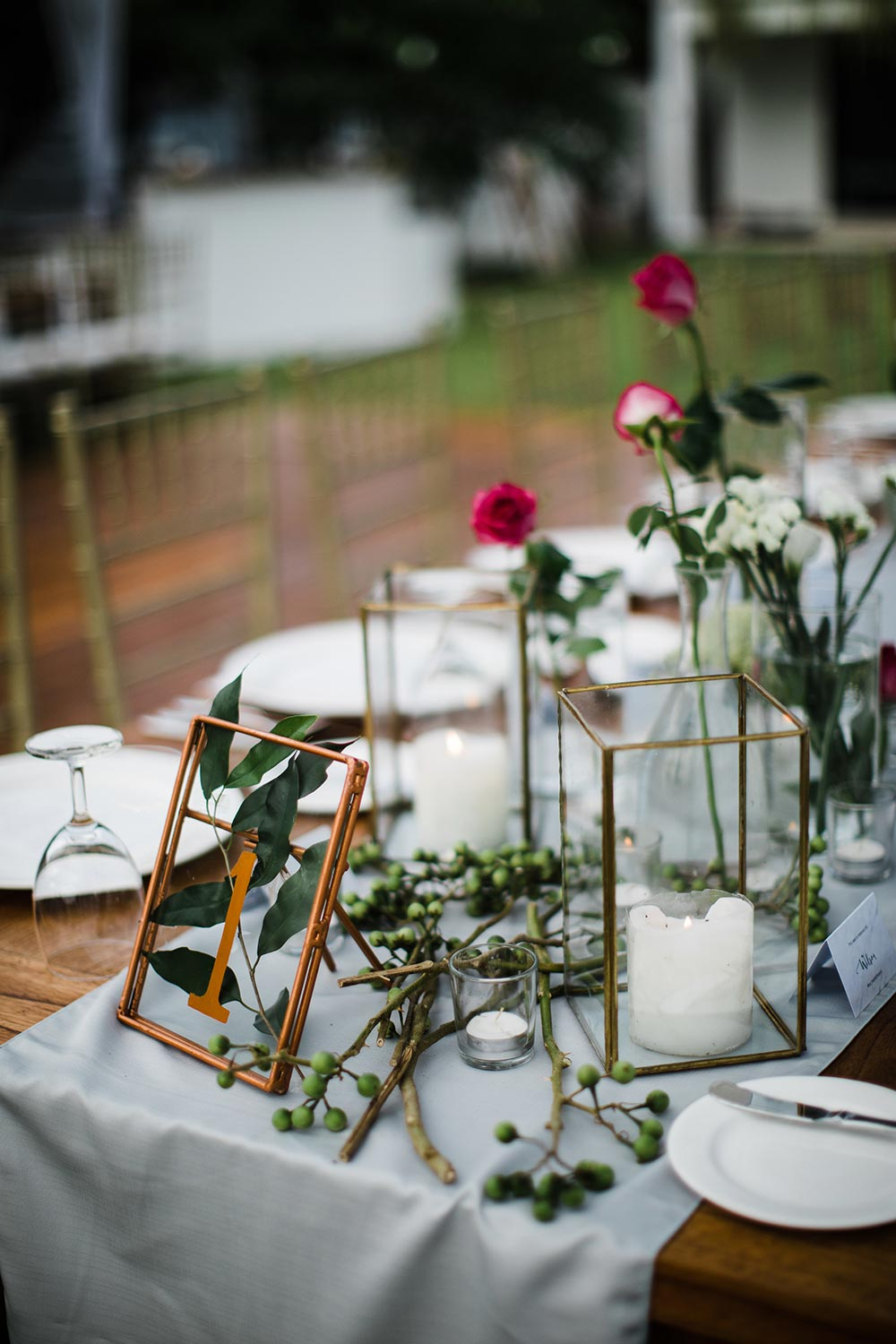copper and glass frame wedding table numbers