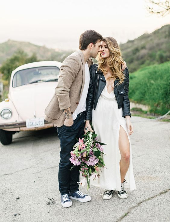 a black leather jacket is a chic statement for a casual or boho bride