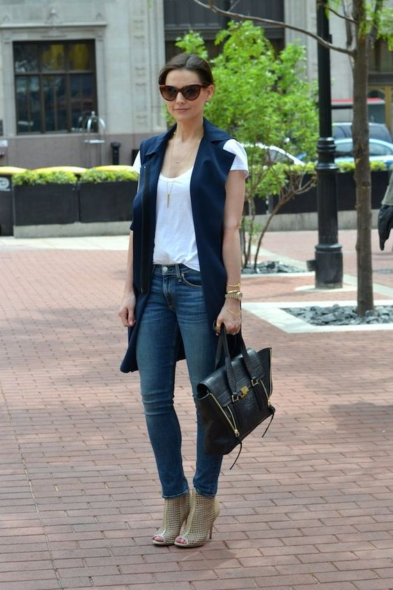 blue skinnies, a white tee, a navy long vest, perforated nude mules