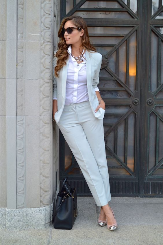 a dove grey pantsuit, a white shirt, printed shoes and a necklace for a business look