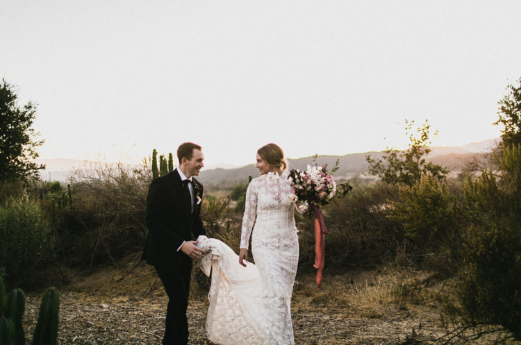 This boho meets modern moody wedding is full of love and moody touches for a desert at sunset look