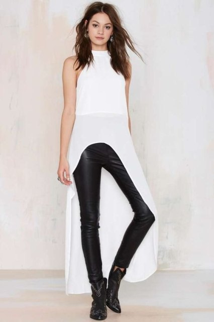 With leather leggings and ankle boots