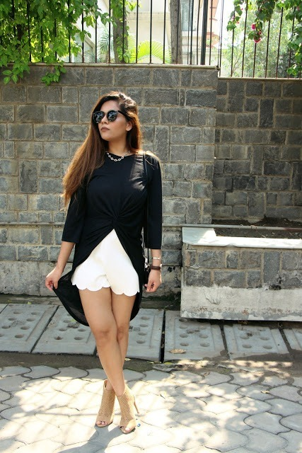 With white scallop shorts and cutout boots