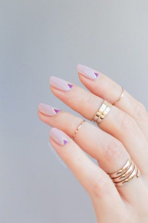 lilac nails with purple tirangle accents can fit a boho or mid-century modern bride
