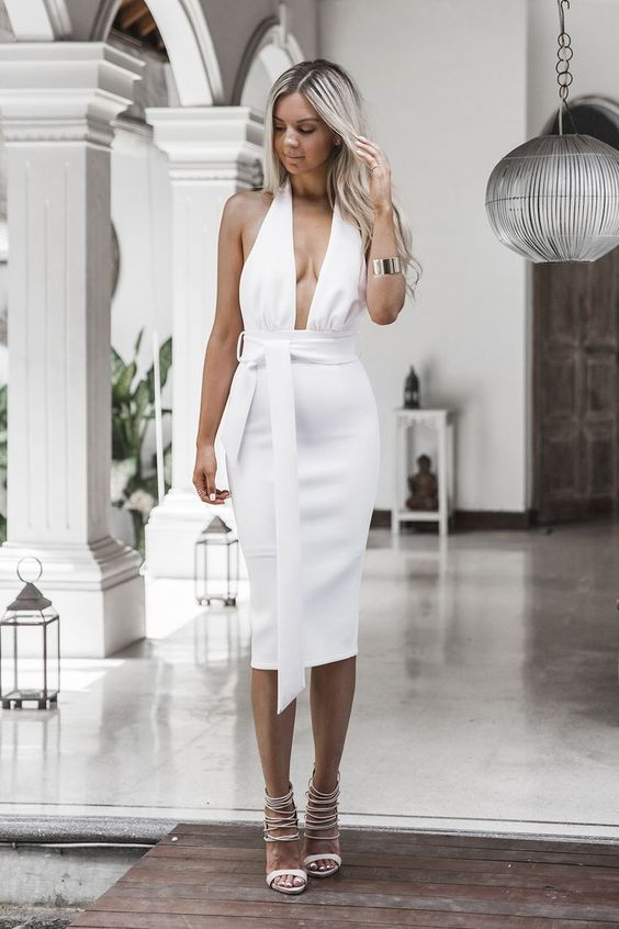 a gorgeous fitting white midi dress with a plunging neckline with blush lace up heels