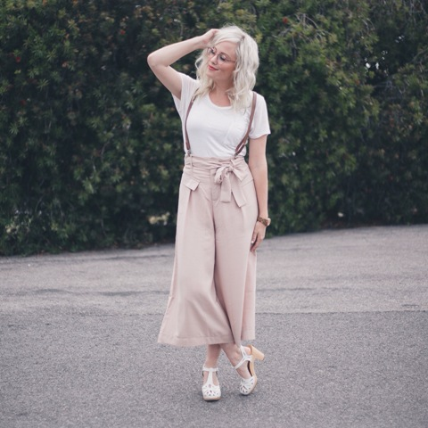 With white t-shirt and white sandals