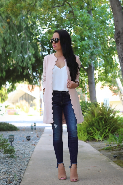With white top, jeans and pale pink cutout boots