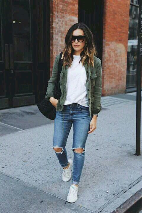 ripped blue skinnies, a white tee, an olive green shirt, white sneakers for a casual look