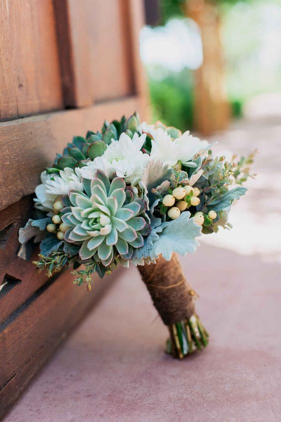 a succulent and white bloom wedding bouquet with a rustic wrap for a chic rustic look