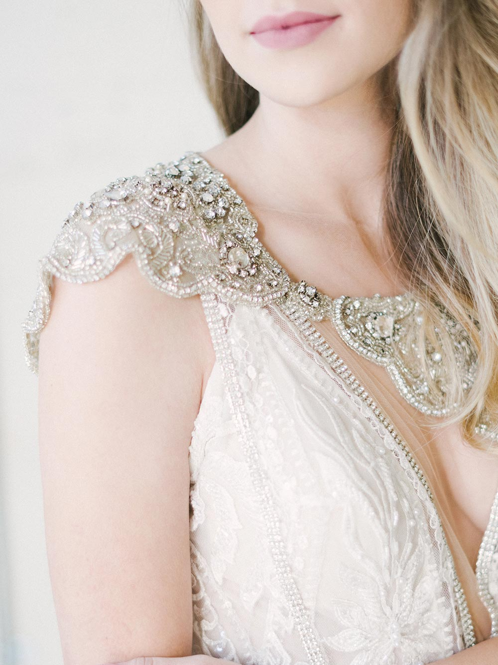 beaded shrug with intricate spaghetti strap wedding dress
