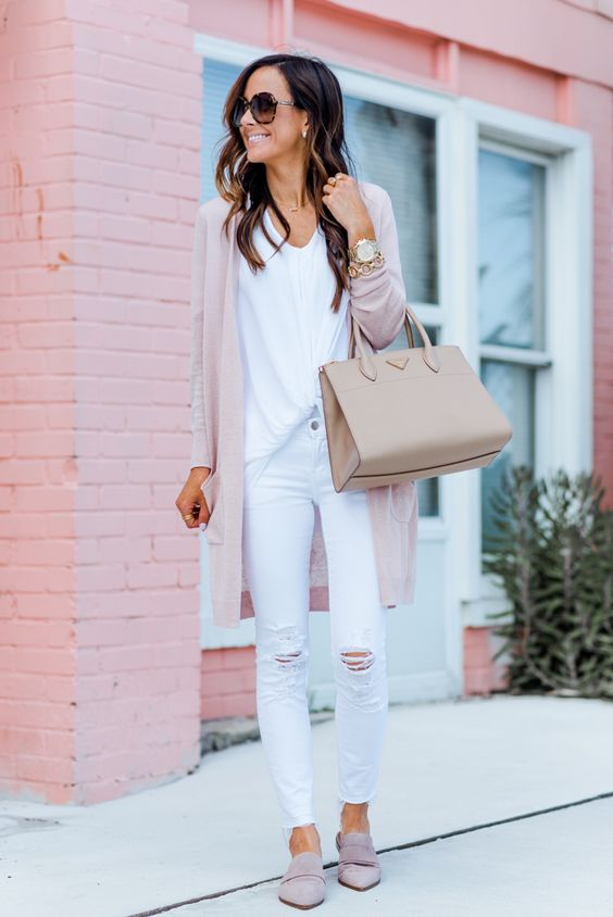 a white top, white ripped jeans, blush flats, a blush cardigan and a neutral bag