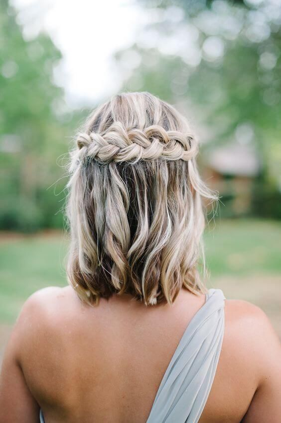 wavy hair down with a braided halo is a nice idea for those who have long bob