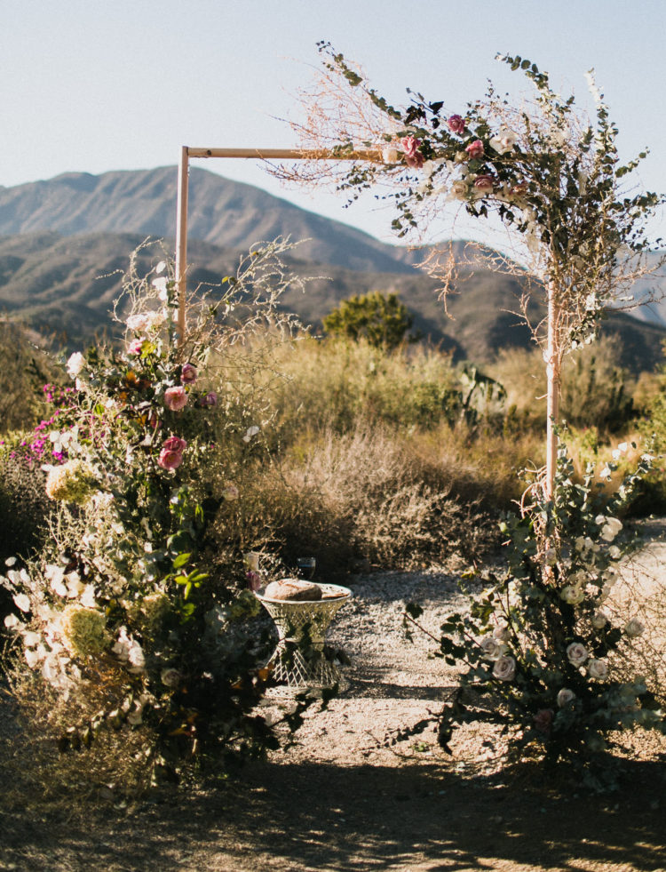 The wedding arch was of tubing and decorated with lush florals and greenery