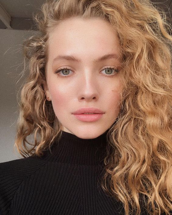 gorgeous naturally light colored hair with curls that bring much dimension