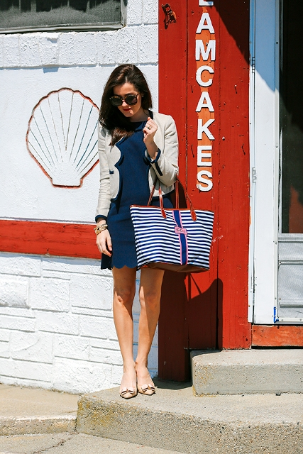 With navy blue dress, beige shoes and striped tote