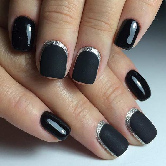 black matte nails with silver moon framing and some glossy black nails