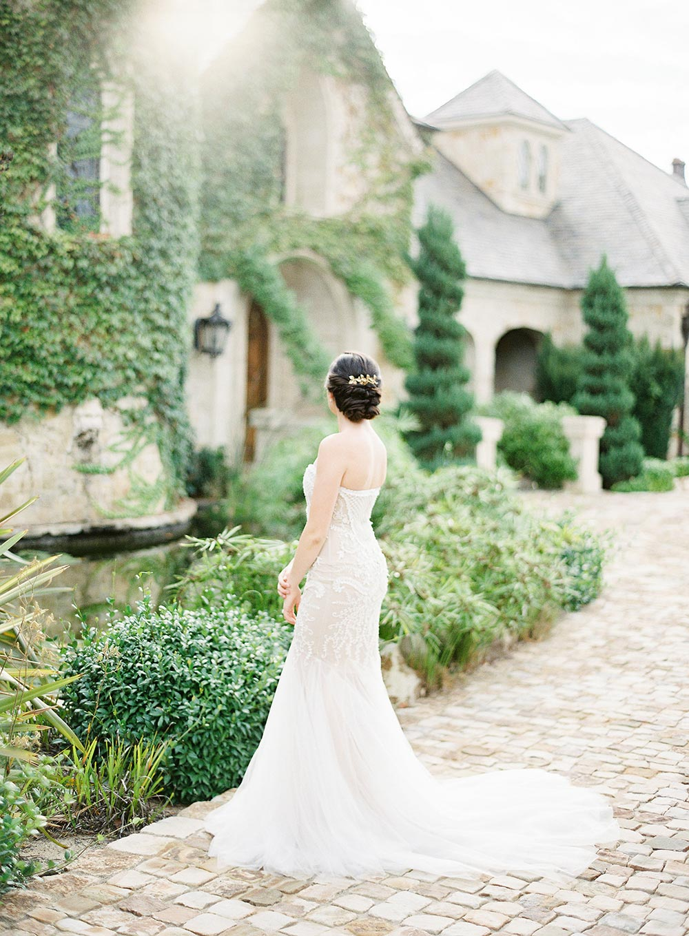 strapless beaded wedding dress and low bridal updo