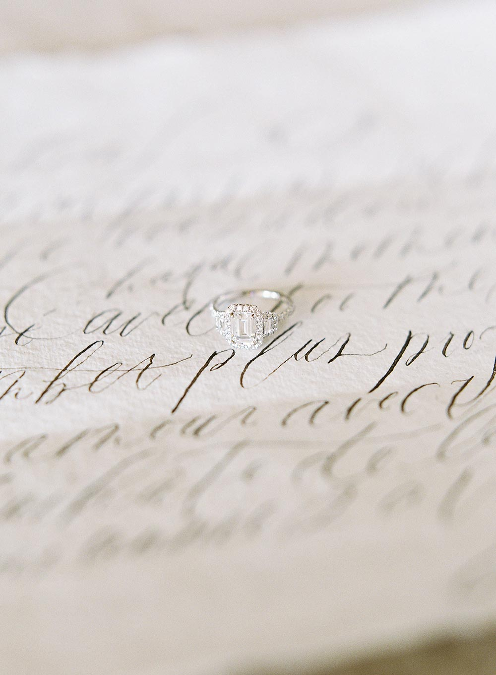 wedding calligraphy and emerald cut engagement ring